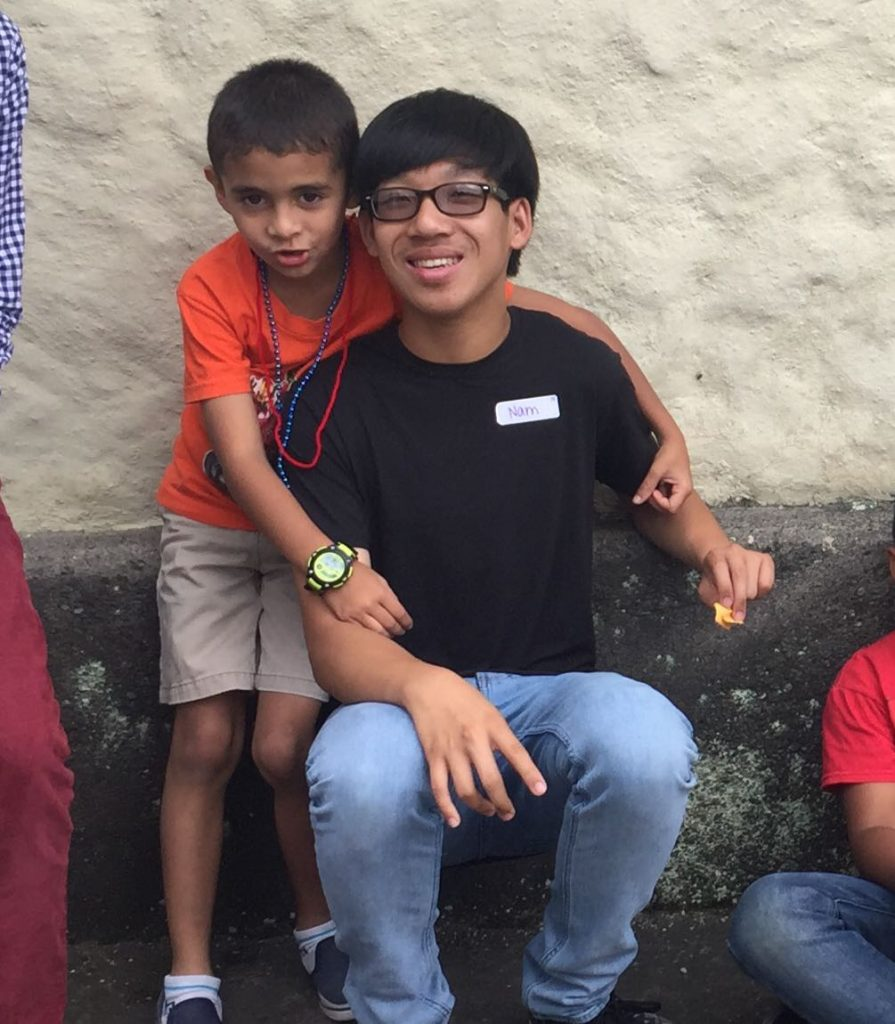 Spanish immersion participant bonding with host brother