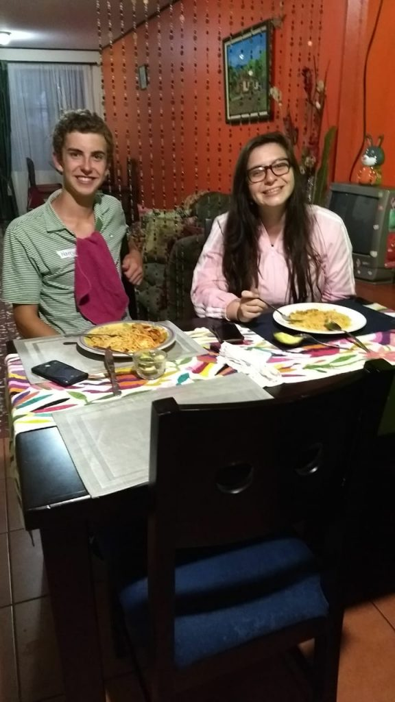 Spanish immersion participant having dinner with host family!