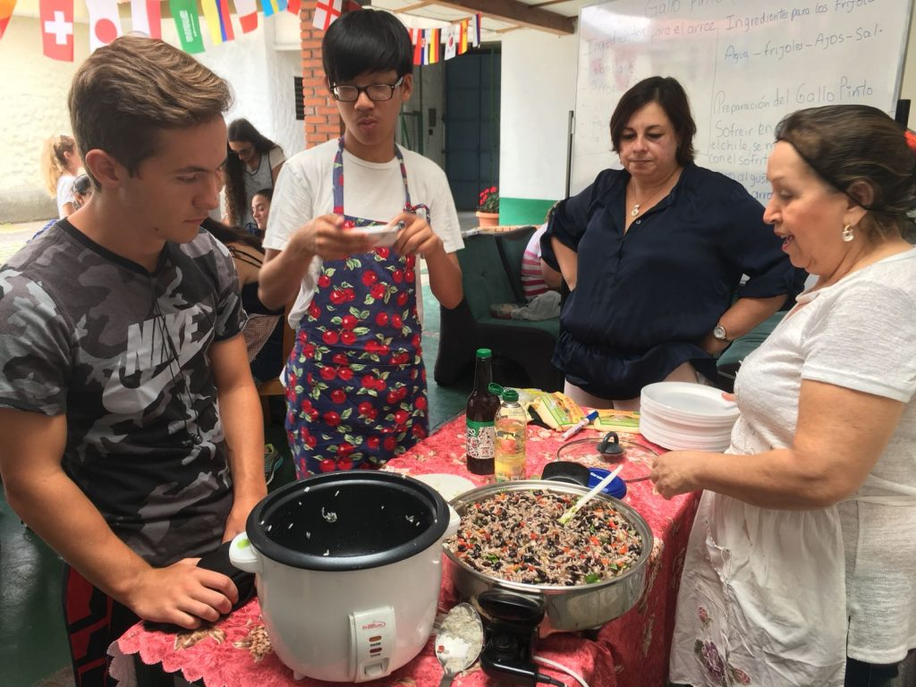 High school Spanish immersion participants cook Gallo Pinto